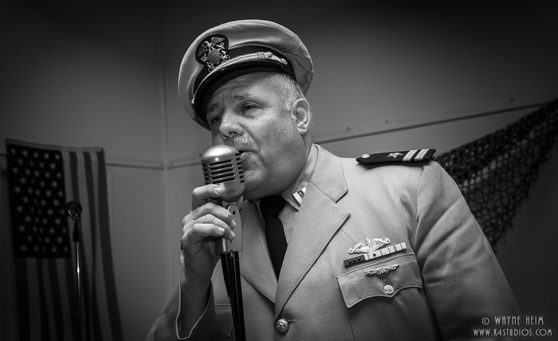 Singing Officer    Black & white Photography by Wayne Heim