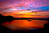 Beautiful sunset reflection over a lake with 3 birds flying overhead. Photography fine art photo prints print photos photograph photographs image images artwork.