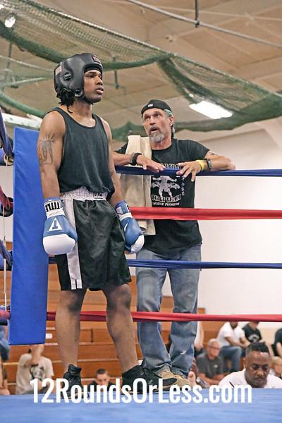 Bout #6:  Devon Siegfried, Red Gloves, Ellwood City B.C., Ellwood, PA   vs.   Dorns Butler, Blue Gloves, Unique Fitness, Akron, OH,   190 Pounds