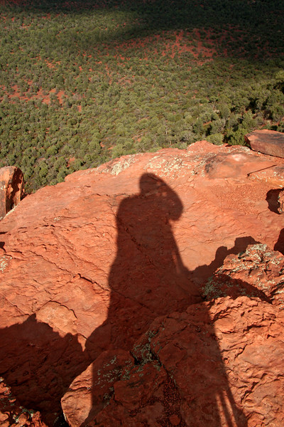 My shadow plays out across the Doe Mountain northern rim.  One of my favorite places to sit at sunset near Sedona.  Less good during a thunder storm...