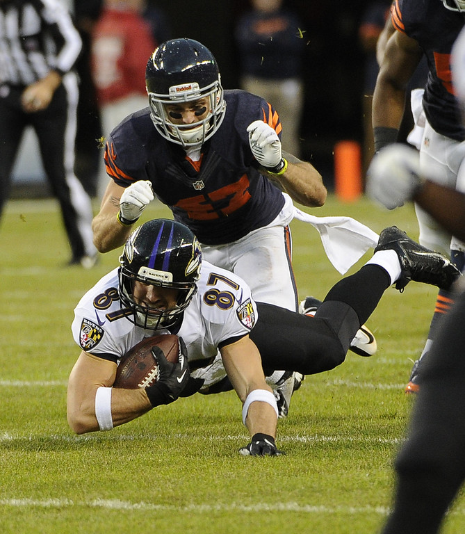 . Dallas Clark #87 of the Baltimore Ravens makes a catch and is tackled by Chris Conte #47 of the Chicago Bears during the first quarter on November 17, 2013 at Soldier Field in Chicago, Illinois. (Photo by David Banks/Getty Images)