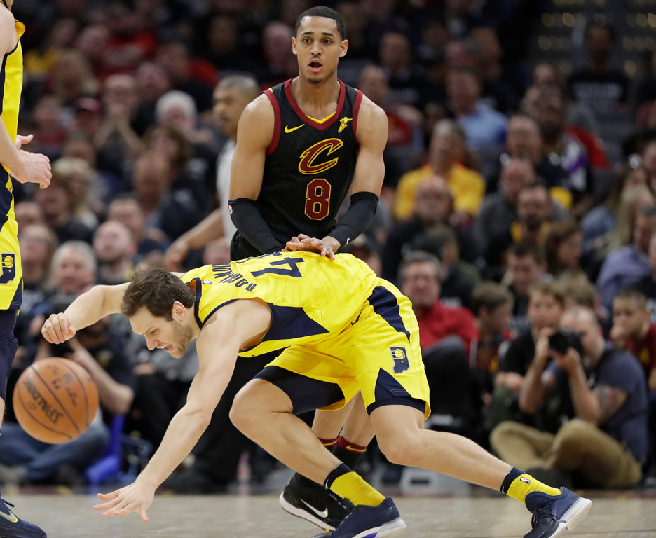 . Indiana Pacers\' Bojan Bogdanovic (44), from Croatia, loses control of the ball under pressure from Cleveland Cavaliers\' Jordan Clarkson (8) in the first half of Game 7 of an NBA basketball first-round playoff series, Sunday, April 29, 2018, in Cleveland. (AP Photo/Tony Dejak)