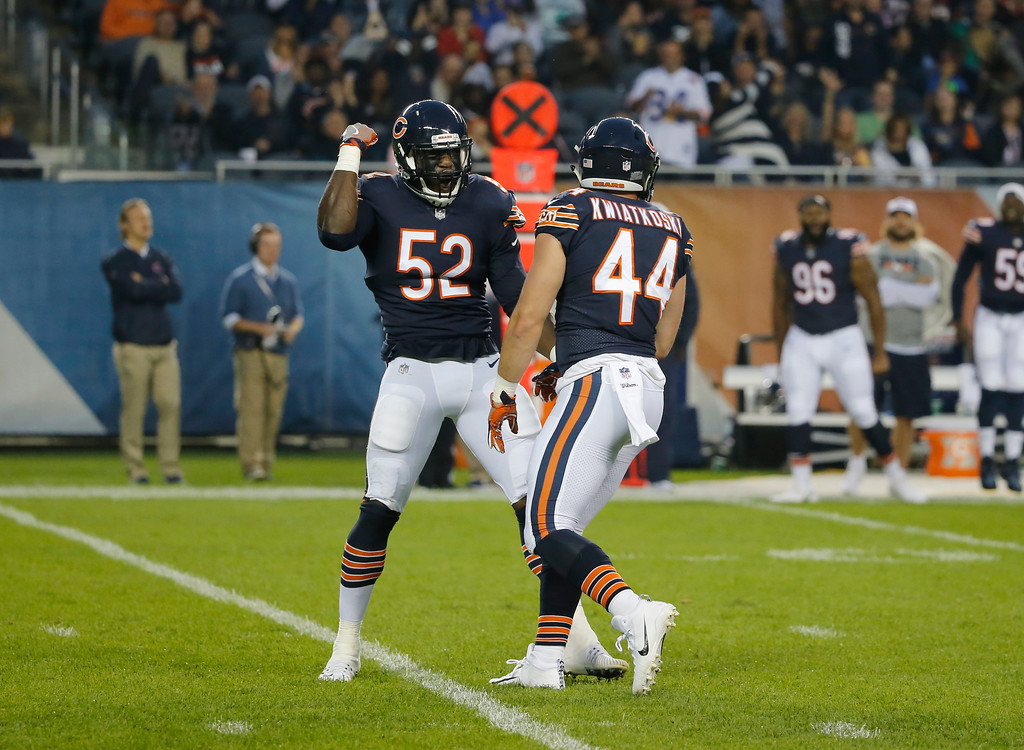 . Chicago Bears inside linebacker Nick Kwiatkoski (44)celebrates with linebacker Christian Jones (52) after a quarterback sack during the first half of an NFL football game against the Cleveland Browns, Thursday, Aug. 31, 2017, in Chicago. (AP Photo/Charles Rex Arbogast)