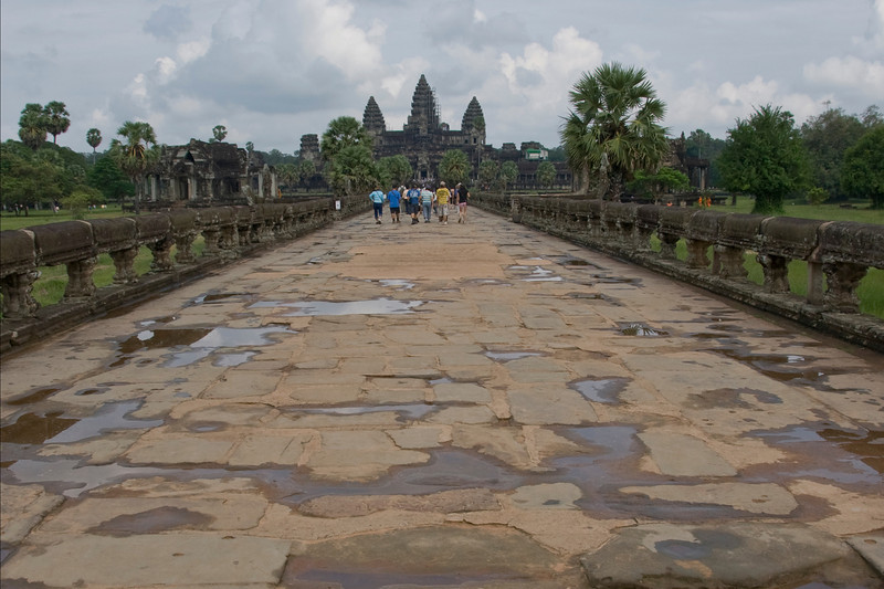 Group of tourists on path to Angkor Wat