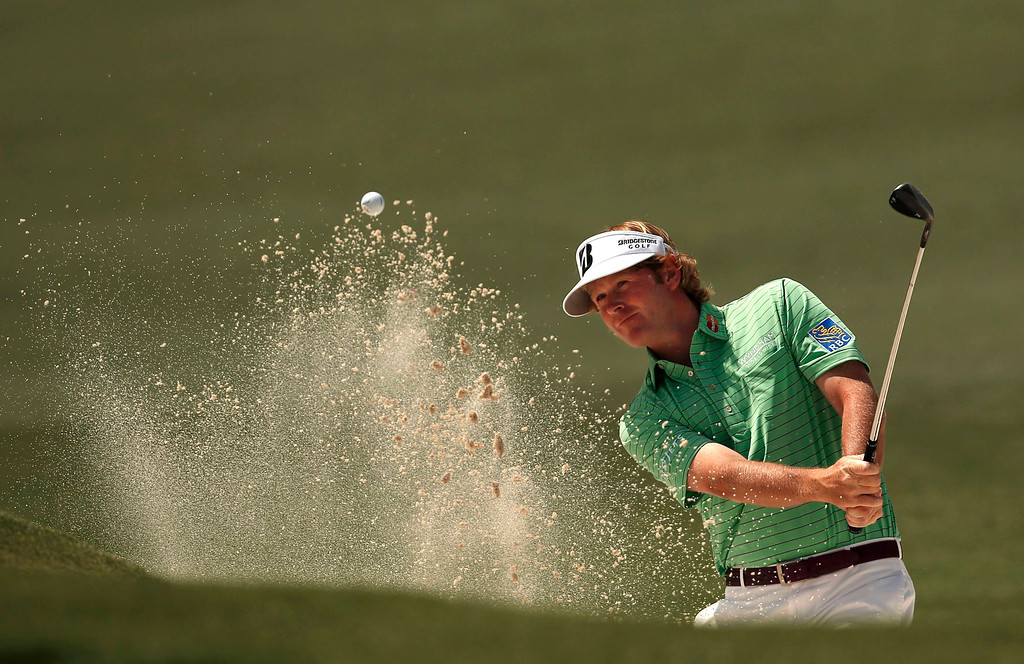 . Brandt Snedeker of the U.S. hits from a sand trap on the second hole during third round play in the 2013 Masters golf tournament at the Augusta National Golf Club in Augusta, Georgia, April 13, 2013.  REUTERS/Mark Blinch