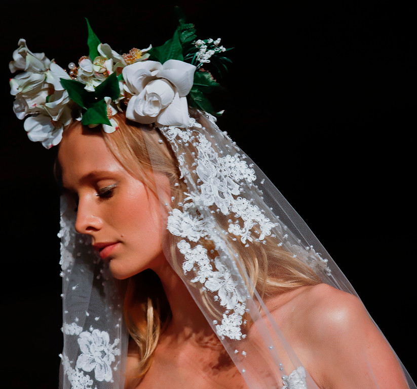 . Bridal fashion from the Reem Acra collection is modeled during Bridal Fashion Week in New York. (AP Photo/Bebeto Matthews, File)