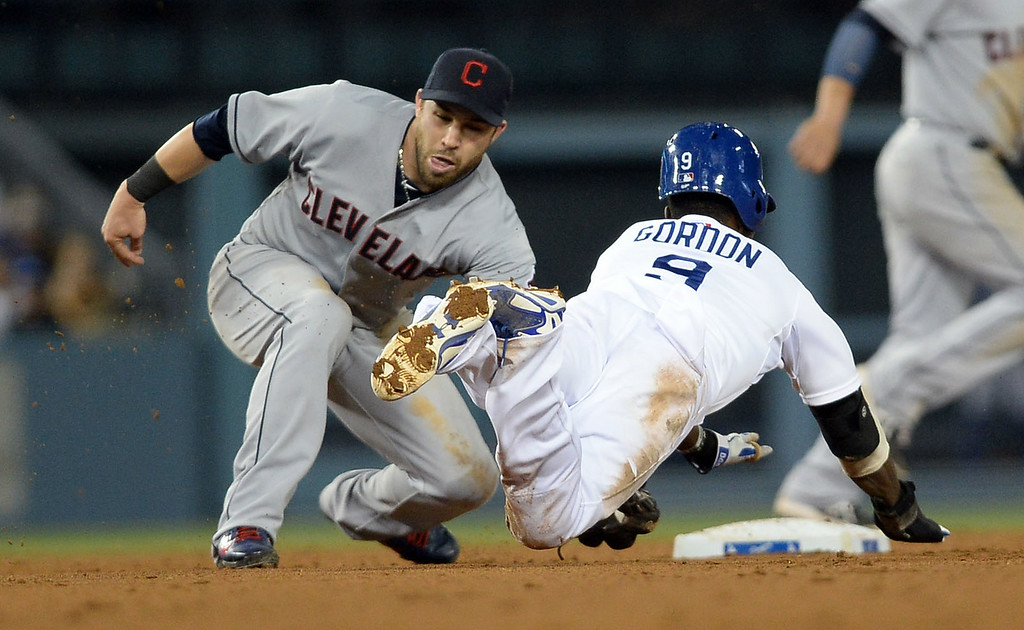 . Los Angeles Dodgers Dee Gordon is tagged out while trying to steal 2nd base against the Cleveland Indians July 1, 2014 in Los Angeles.(Andy Holzman/Los Angeles Daily News)