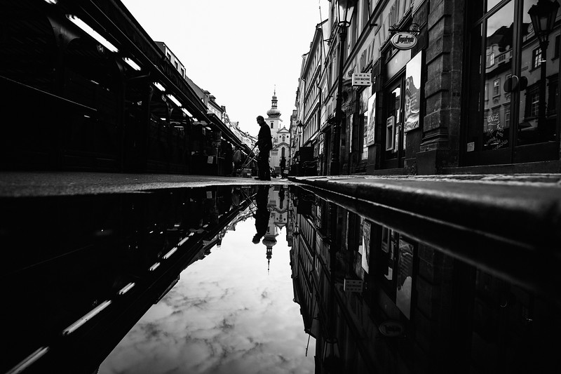 market man sweeping reflection prague mono.jpg