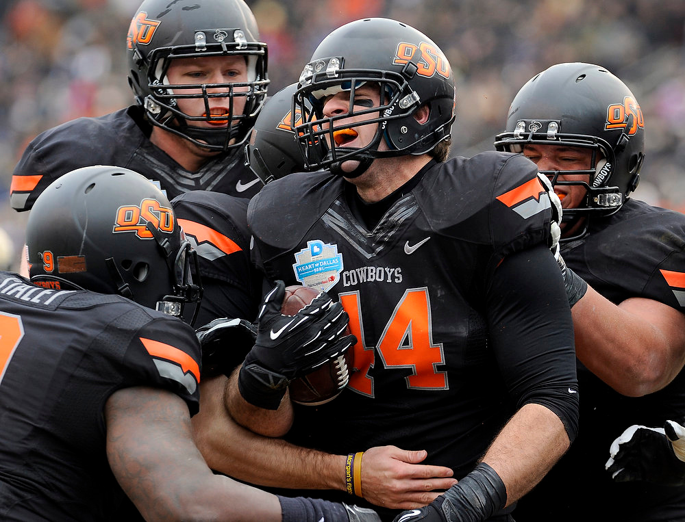 . Oklahoma State tight end Jeremy Seaton (44) celebrates with teammates after a first-half touchdown against Purdue during the Heart of Dallas Bowl NCAA college football game, Tuesday, Jan. 1, 2013, in Dallas. (AP Photo/Matt Strasen)