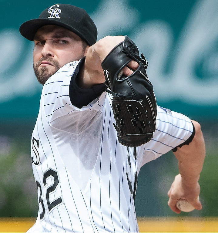 . Tyler Chatwood #32 of the Colorado Rockies delivers a pitch in the first inning of a game against the Cincinnati Reds at Coors Field on September 1, 2013 in Denver, Colorado. (Photo by Dustin Bradford/Getty Images)