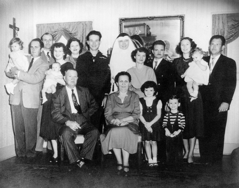 George & Bertha Jacob Family Christmas 1952  Left to right: Top row; Walter 'Rip' Smock holding Janice Smock, Ed Gutowsky, Maria Jacob Smock holding Jimmy Smock, Teddy Jacob Gutowsky, George Jacob Jr, Sister Clara Jacob, Daria Jacob Curry, Carl Curry, Frieda Jacob Wick, Bob Wick holding Barbara Wick Bottom row; George Jacob Sr, Bertha Seiffert Jacob, Sharon Curry, Jerry Curry