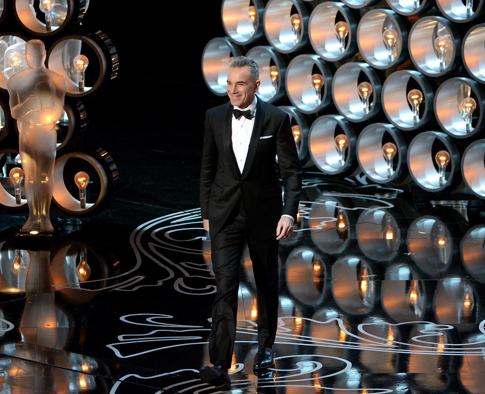 . Presenter Daniel Day-Lewis walks on stage during the Oscars at the Dolby Theatre on Sunday, March 2, 2014, in Los Angeles.  (Photo by John Shearer/Invision/AP)