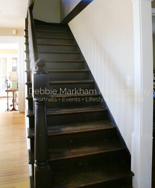Greystone Manor Stairs from Living Room-Cambria Real Estate.jpg