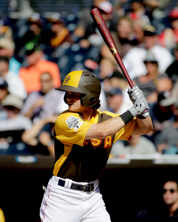 . U.S. Team\'s Andrew Benintendi, of the Boston Red Sox, hits against the World Team during the first inning of the All-Star Futures baseball game, Sunday, July 10, 2016, in San Diego. (AP Photo/Matt York)