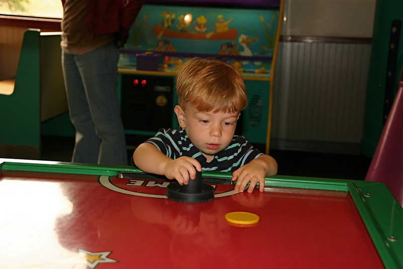 Gabey loves air hockey.
