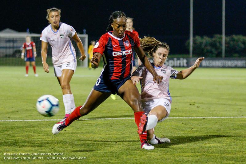 Houston Dash defender Allysha Chapman (4) clears the ball before Washington Spirit forward Cheyna Matthews (20) can take a shot at Maureen Hendricks Field in Boyds, MD, on July 20, 2019.