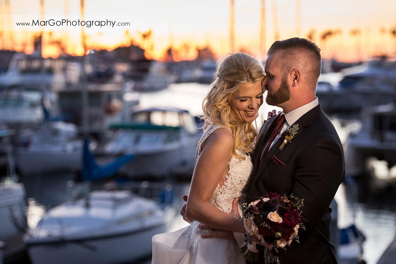 bride and groom hugging during sunset at San Diego Marina Village