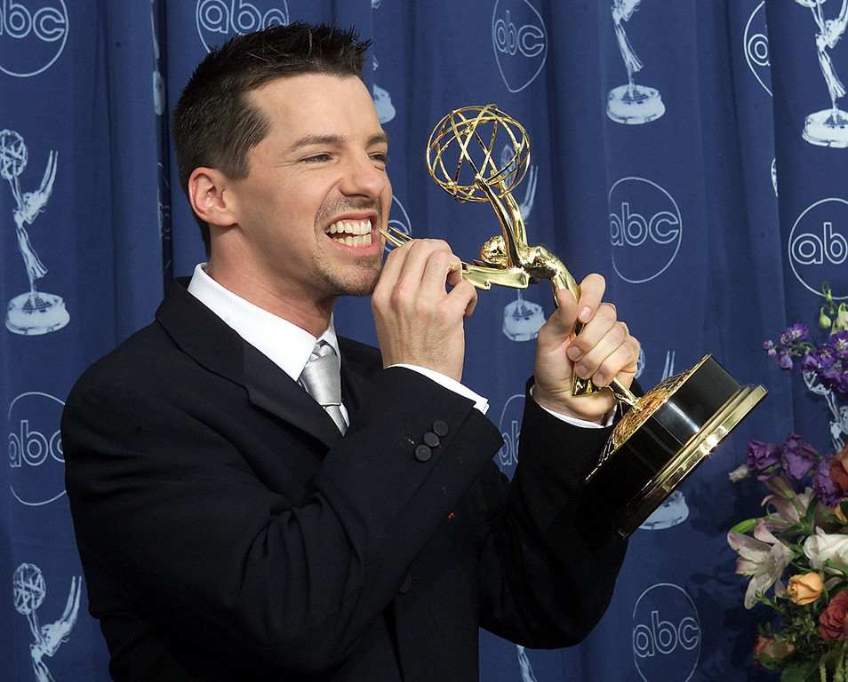 """. Actor Sean Hayes hold his trophy for \""""Supporting Actor in a Comedy Series\"""" category for his role in \""""Will and Grace\"""" during the 52nd Annual Primetime Emmy Awards at the Shrine Auditorium in Los Angeles 10 September, 2000.   Scott Nelson/AFP/Getty Images"""