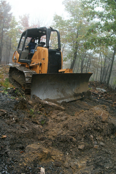 Here's the rain out.  We got about 1/2 inch of rain.  I got the backhoe stuck in about a foot of mud and it took the bulldozer to pull me out.