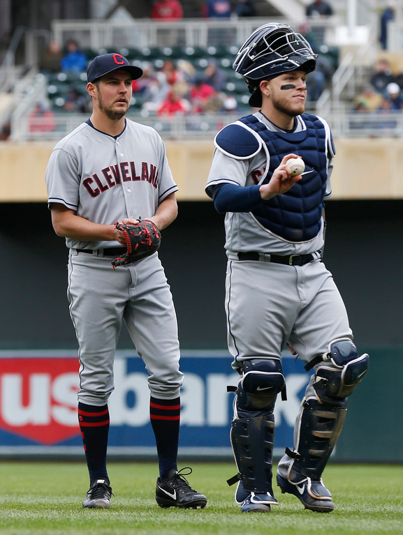 . Cleveland Indians catcher Roberto Perez, walks back to the plate after a talk with pitcher Trevor Bauer after he walked Minnesota Twins\' Robbie Grossman to load the bases in the fourth inning of a baseball game against the Minnesota Twins Thursday, April 20, 2017, in Minneapolis. (AP Photo/Jim Mone)