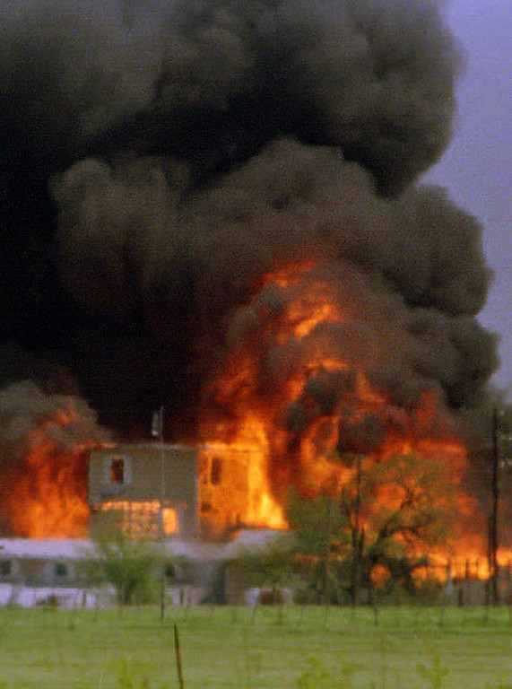 . The Branch Davidian cult compound observation tower in Waco, TX is engulfed in flames after a fire, apparently started from inside the compound, burns the complex to the ground 19 April 1993. The fire was started after federal agents began pumping teargas into the headquarters of the cult led by David Koresh.  TIM ROBERTS/AFP/Getty Images
