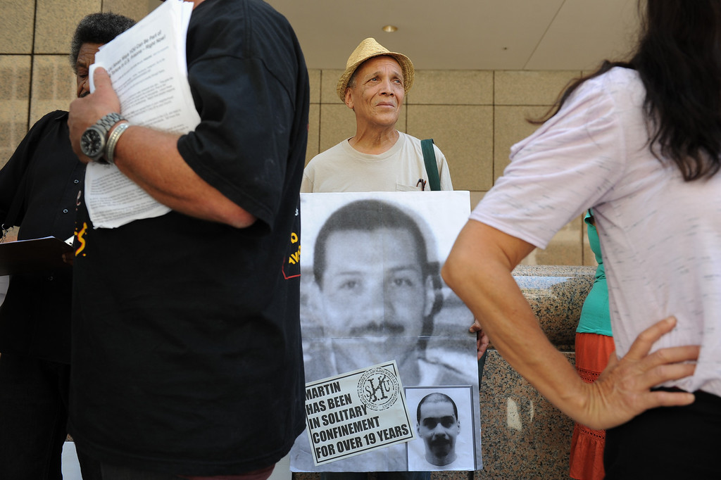 . John A. Imani holds a sign outside the Ronald Reagan State Building in downtown L.A. Monday, July 8, 2013, during a protest against solitary confinement in California prisons. (Michael Owen Baker/L.A. Daily News)