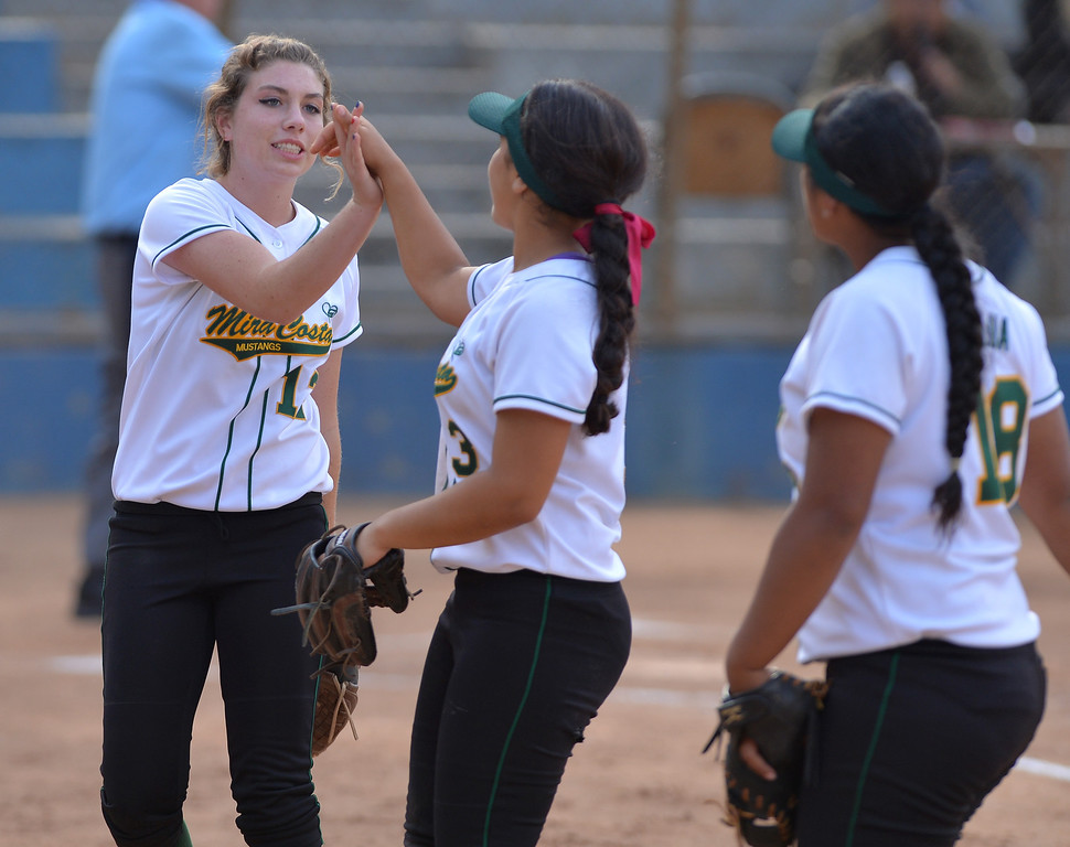 . 0517_SPT_TDB-L-MC-TORRANCE--- Torrance, CA--5/16/13--- Staff Photo: Robert Casillas  - Daily Breeze / LANG--- Mira Costa defeated Torrance High 7-1 in CIF DIV III softball playoff game at Wilson Park in Torrance. Mira Costa pitcher Dillan Boada, left, slaps hands with Brittany Werre after her strikeout of a Torrance batter ended the inning