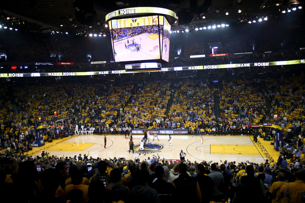 . Fans watch from a general view of Oracle Arena the opening tip off during the first half of Game 1 of basketball\'s NBA Finals between the Golden State Warriors and the Cleveland Cavaliers in Oakland, Calif., Thursday, May 31, 2018. (AP Photo/Ben Margot)