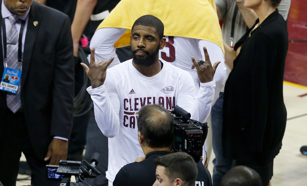 . Cleveland Cavaliers guard Kyrie Irving gestures after the Cavaliers defeated the Golden State Warriors 137-116 in Game 4 of basketball\'s NBA Finals in Cleveland, early Saturday, June 10, 2017. (AP Photo/Ron Schwane)