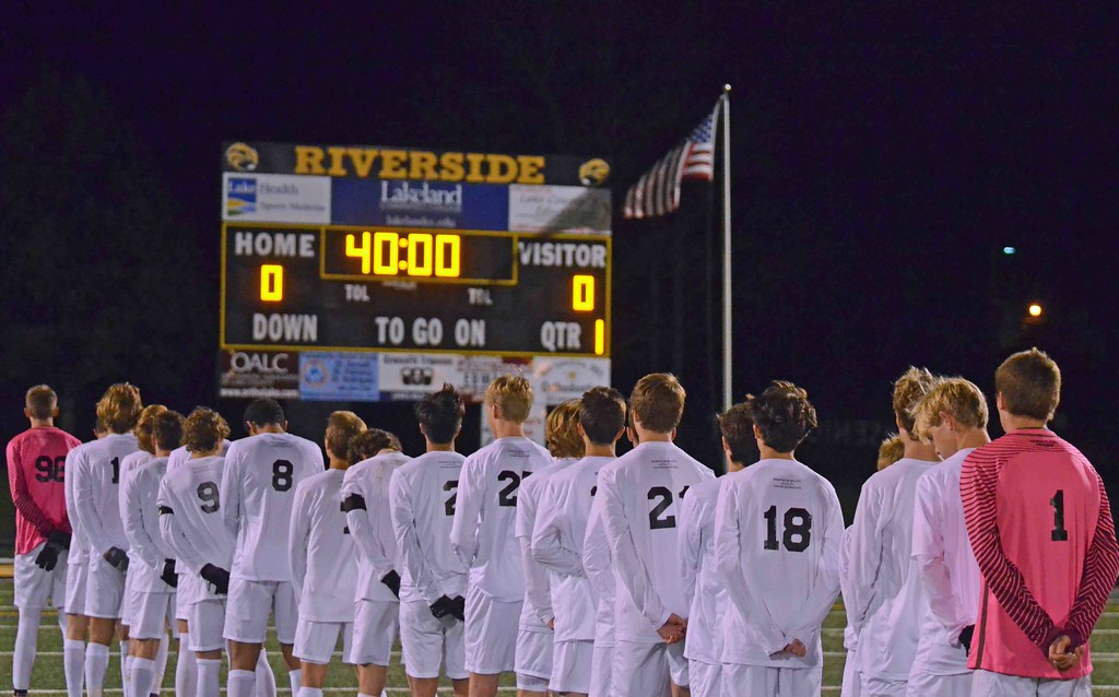 . Paul DiCicco - The News-Herald University lines up for the national anthem Oct. 28 prior to a Division II district final against Lake Catholic at Riverside.