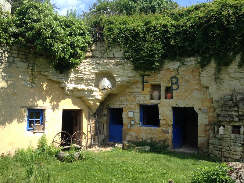Partially underground house carved from stone.