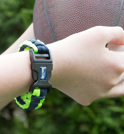 Seattle Seahawks bracket on young football player.