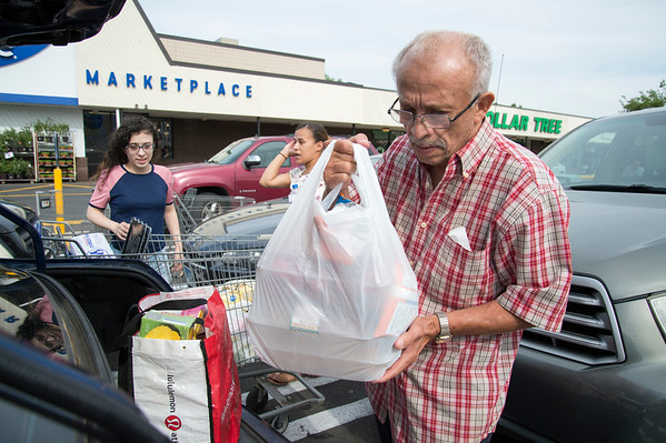 06/07/19 Wesley Bunnell | Staff Goerge Rodriguez loads his grocery with a combination of one time use and reusable bags into his car outside of Price Rite in New Britain on Friday afternoon.