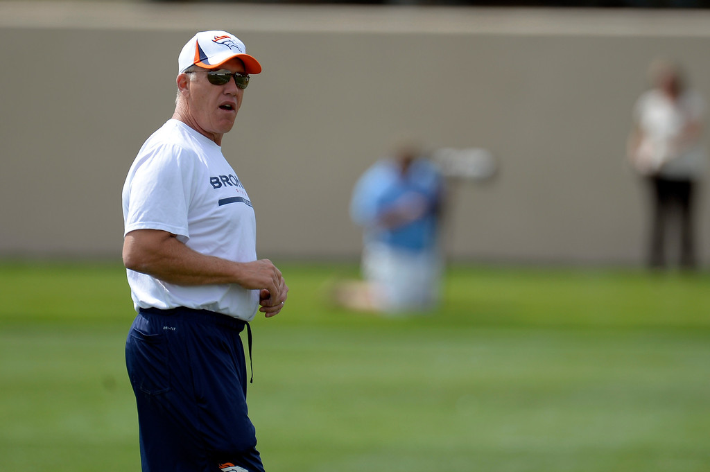 . Denver Broncos Executive VP of Football Operations John Elway looks on during practice August 23, 2013 at Dove Valley (Photo by John Leyba/The Denver Post)