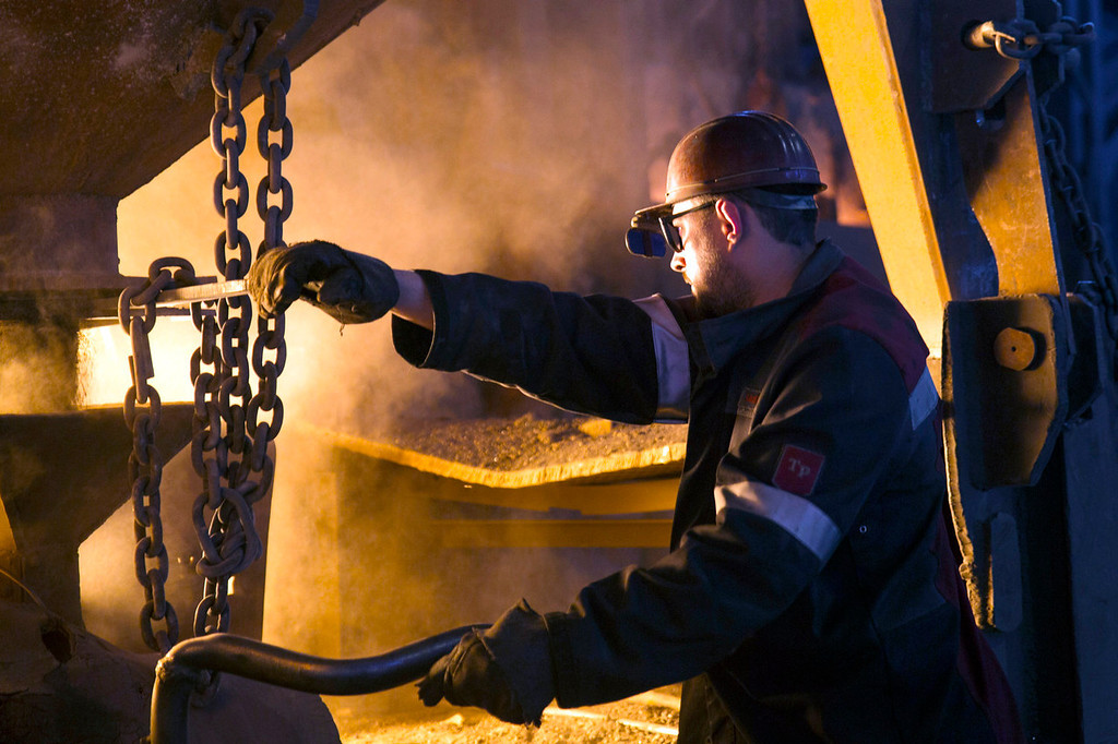 . An employee operates machinery at the scrap metal furnace inside the Zaporizhstal steel plant, owned and operated by Metinvest BV, at their site in Zaporizhzhya, Ukraine, on Monday, Oct. 14, 2013. Metinvest BV, Ukraine\'s largest steelmaker, last year acquired 49.9% in steelmaker Zaporizhstal a manufacturer of semi-finished steel products, including hot and cold-rolled plates and coils. Photographer: Vincent Mundy/Bloomberg