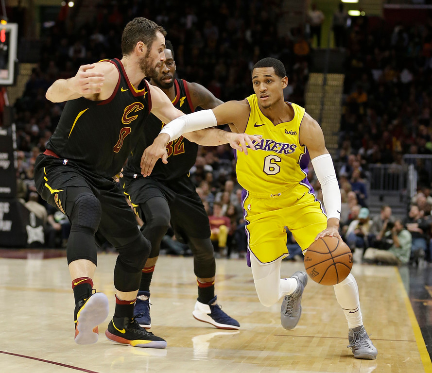 . Los Angeles Lakers\' Jordan Clarkson (6) drives past Cleveland Cavaliers\' Kevin Love (0) in the second half of an NBA basketball game, Thursday, Dec. 14, 2017, in Cleveland. (AP Photo/Tony Dejak)