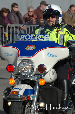 Ottawa Police. Motorcycle police escort for dignitaries at the 2009 Remembrance Day Ceremony in Ottawa, Ontario.  © Rob Huntley
