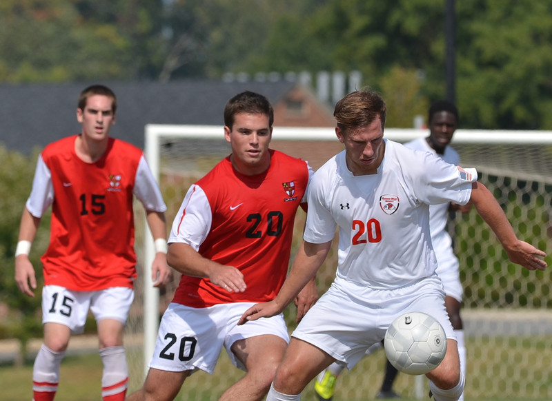 John Sargent (20) works hard to keep the ball from the opposing side.
