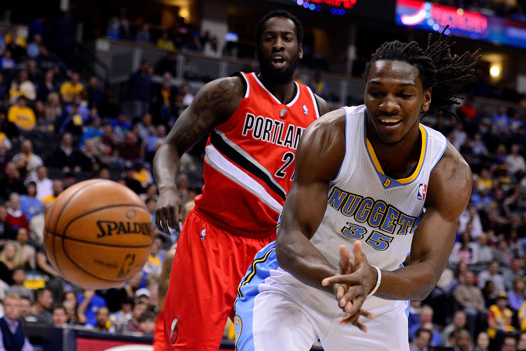 . DENVER, CO - APRIL 14: Kenneth Faried (35) of the Denver Nuggets and J.J. Hickson (21) of the Portland Trail Blazers cannot wrangle a loose ball during the first half of action. The Denver Nuggets play the Portland Trail Blazers at the Pepsi Center. (Photo by AAron Ontiveroz/The Denver Post)