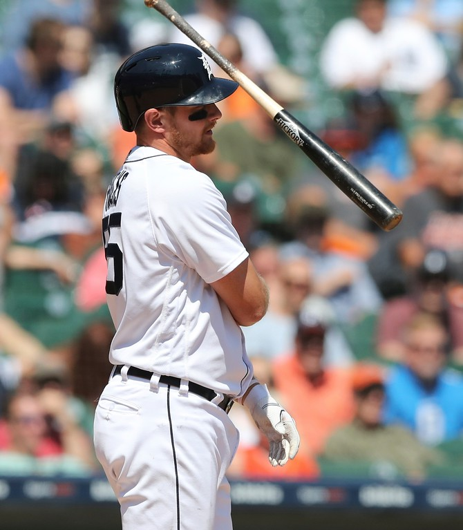 . Detroit Tigers\' John Hicks tosses his bat after striking out during the seventh inning of a baseball game against the Cleveland Indians, Wednesday, May 16, 2018, in Detroit. (AP Photo/Carlos Osorio)