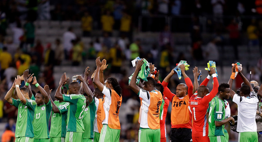 . Nigerian players applaud spectators after the group F World Cup soccer match between Iran and Nigeria at the Arena da Baixada in Curitiba, Brazil, Monday, June 16, 2014. The match ended in a 0-0 draw.   (AP Photo/Fernando Vergara)