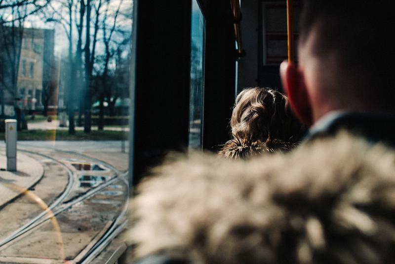 a pair of fur coats window tram man woman looking ou thte window ochota warsaw poland nikon.jpg
