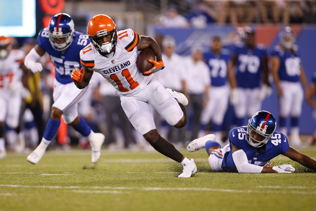 . Cleveland Browns wide receiver Antonio Callaway (11) runs away from New York Giants\' Orion Stewart (45) and Tae Davis (58) for a touchdown during the second half of a preseason NFL football game Thursday, Aug. 9, 2018, in East Rutherford, N.J. (AP Photo/Adam Hunger)