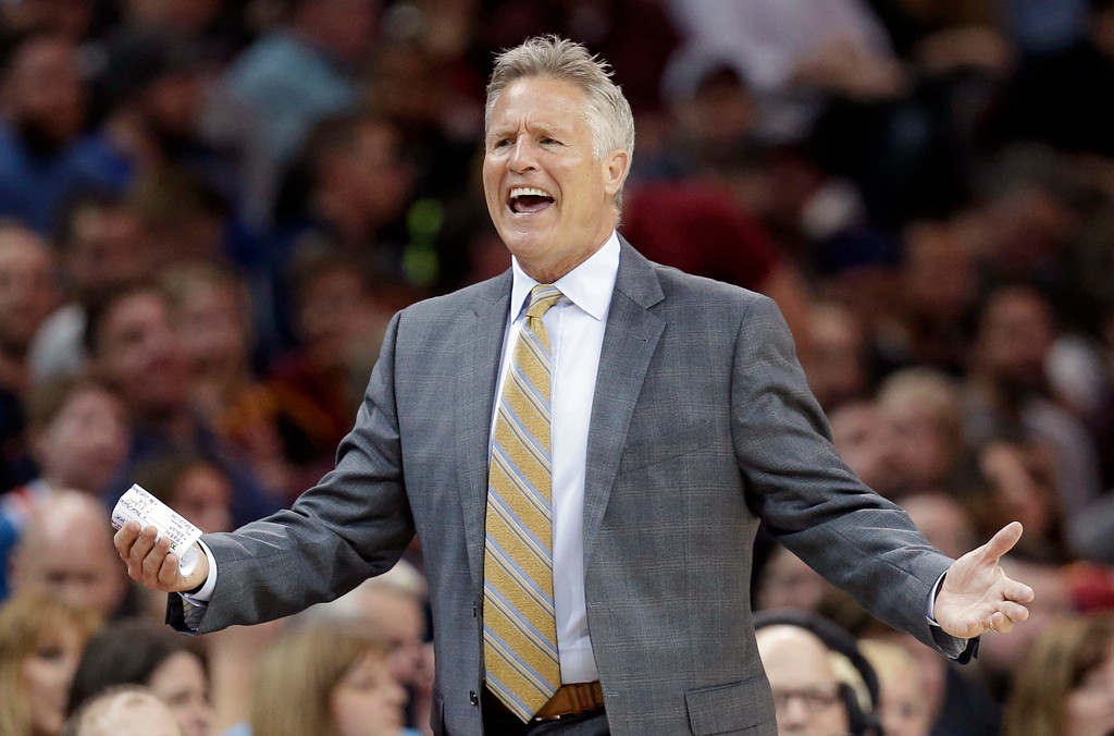 . Philadelphia 76ers head coach Brett Brown yells to an official in the first half of an NBA basketball game against the Cleveland Cavaliers, Friday, March 31, 2017, in Cleveland. (AP Photo/Tony Dejak)
