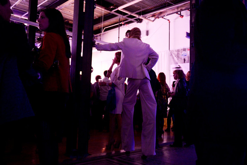 . DENVER, CO. - FEBRUARY 7: George Peele, standing on stilts, watches models work the runway during the Whiteout 2013 at the McNichols Building. The winter-themed show and art exhibit celebrates local artists and designers. (Photo By AAron Ontiveroz/The Denver Post)