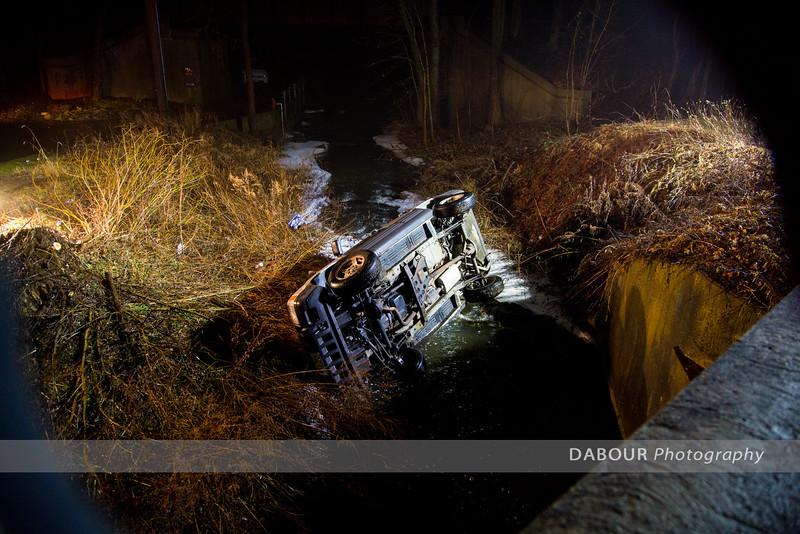 Car Into Creek On Prospect Street