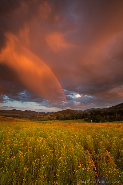 Sunset and rainbow after a storm, near Winthrop, Washington
