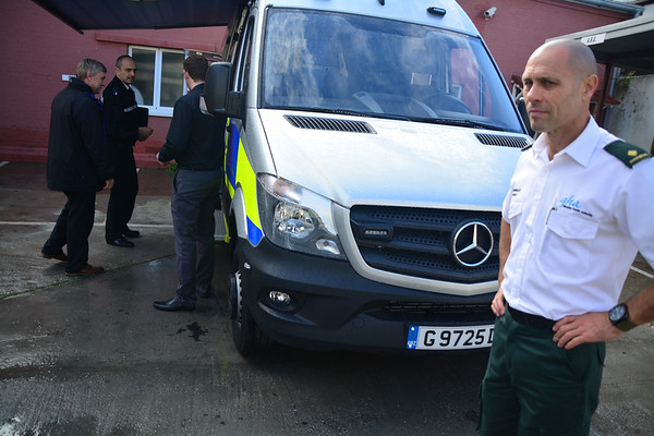 Gibraltar – 3rd December 2014 – Pictured Minister Steven Linares checks the new Command Support Unit as paramedics watch during the unveiling of the vehicle. Gibraltar Government Minister Steven Linares today officially handed over to the Director of  the Emergency Contingency Plan unit, Leslie Edmonds the keys of the newly acquired inter-agency Command Support Unit vehicle at a the Royal Gibraltar Police Rosia Compound in Gibraltar. The vehicle, which will act as a key control centre in major incidents is the latest acquisitions as a new contingency emergency plan is introduced by the Government. The inter-agency vehicle, run primarily by the Royal Gibraltar Police, will see the mobile unit bringing ground command control between emergency services together. Fully equipped, with satellite links, thermal imaging cameras, control and radio facilities the vehicle is expected to act as the main mobile unit deployed to major incidents. The unveiling of the vehicle took place just hours before a planned live aircraft disaster exercise which will see the vehicle tested in real live conditions for the first time. The unit is among the key areas of assessment in the exercise. The Civil Aviation Authority will today be assessing the essential services response to a major aircraft disaster as part of the emergency assessments undertaken to licence the use of the airfield for commercial use.