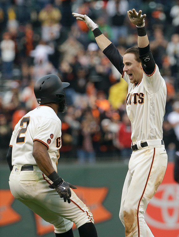 . San Francisco Giants\' Matt Duffy, right, is congratulated by Denard Span (2) after doubling to score Conor Gillaspie for the winning run against the Colorado Rockies during the thirteenth inning of a baseball game in San Francisco, Saturday, May 7, 2016. The Giants won 2-1. (AP Photo/Jeff Chiu)