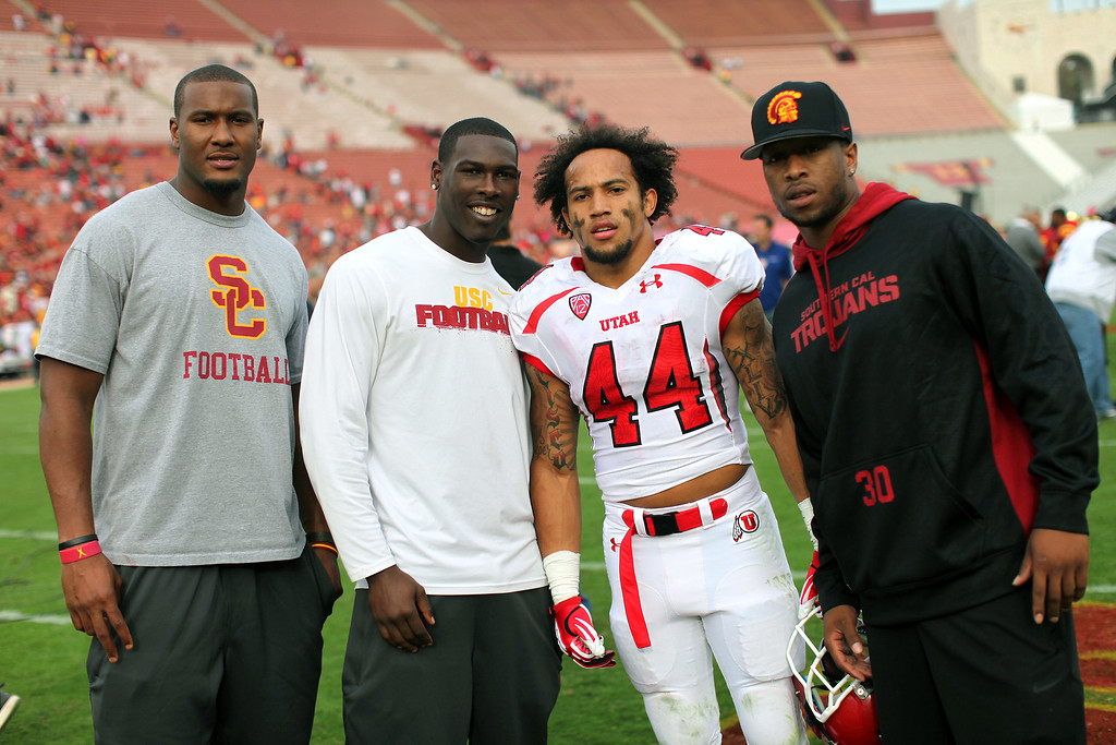 . Utah RB Lucky Radley stands for a picture with the USC injured, from left, Xavier Grimble, Marqise Lee and D.J. Morgan after the game, Saturday, October 26, 2013, at the L.A. Memorial Coliseum. (Michael Owen Baker/L.A. Daily News)